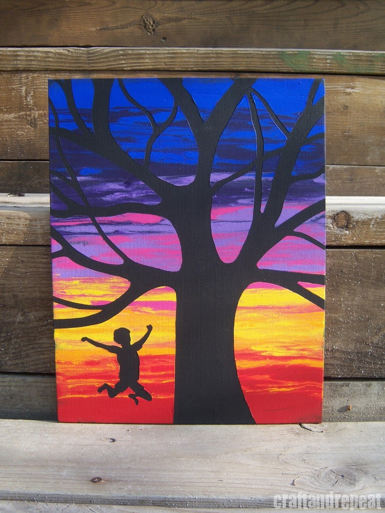 Wet canvas silhouettes painting with water for Painting on black canvas tips