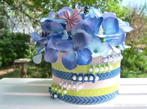 Beaded washi tape vase with washi tape floral embellishments.
